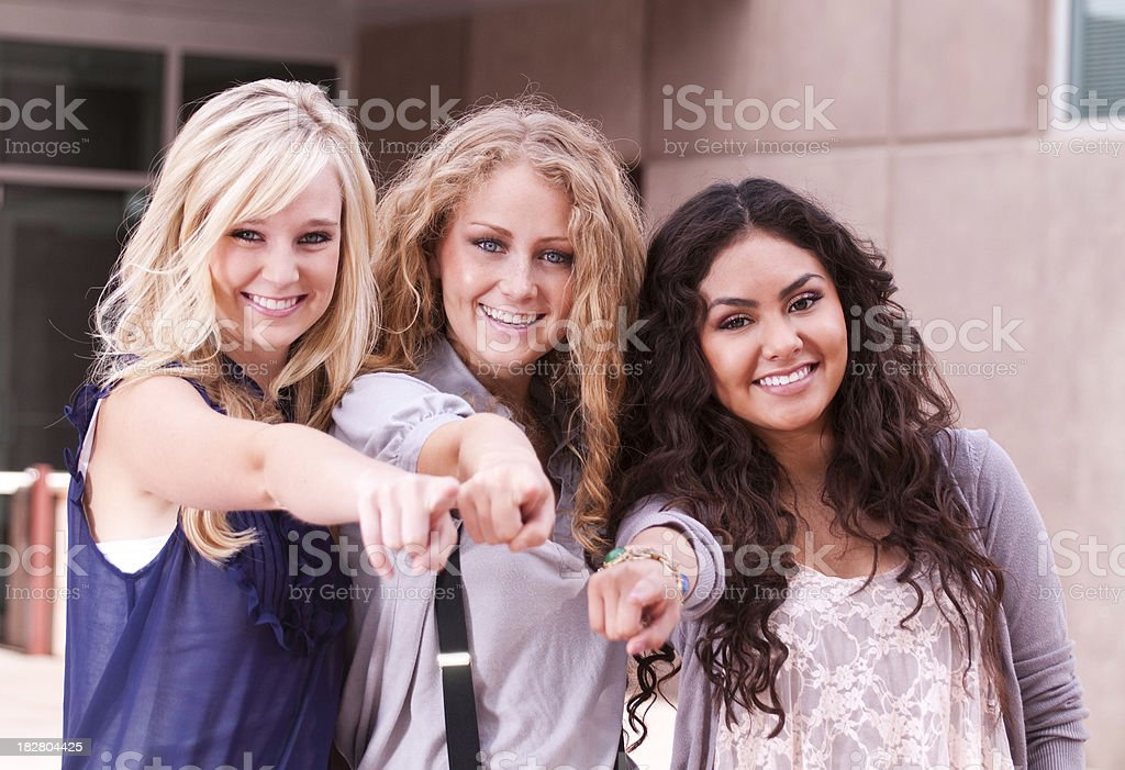 Young Women Pointing: Join Us! royalty-free stock photo