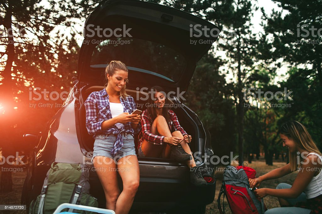 Young Women Preparing For Hike and Camping In Forest. stock photo