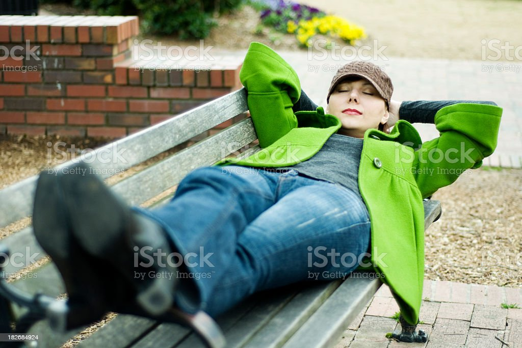 Young Women resting on park bench royalty-free stock photo