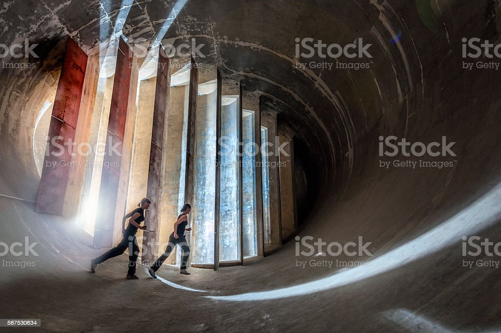 young women running in futuristic environment stock photo