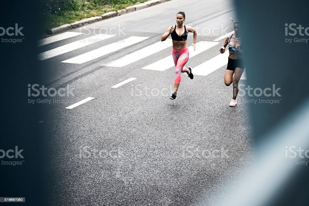 Young women running on the streets stock photo