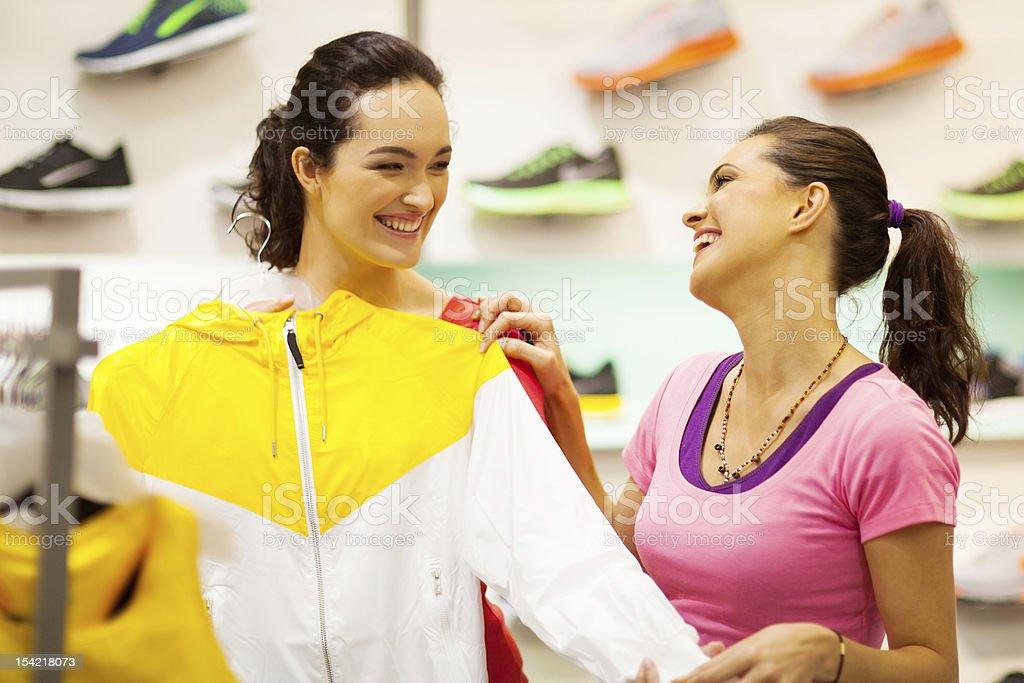 young women shopping for sportswear stock photo