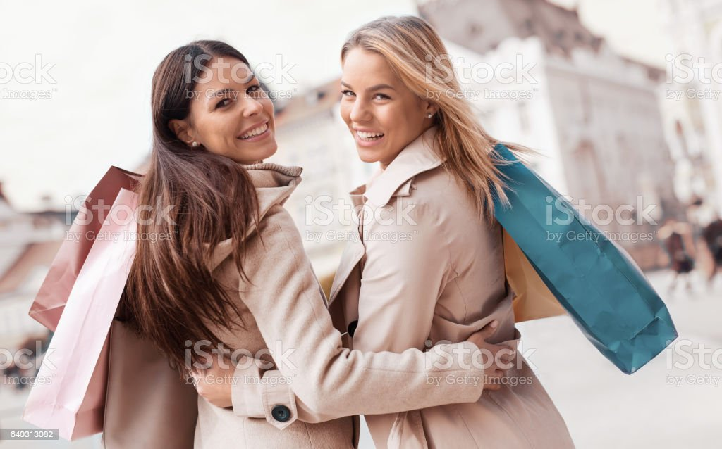Young women shopping together. Consumerism and lifestyle stock photo