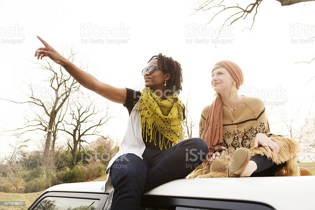 Young Women Sitting on a Car stock photo