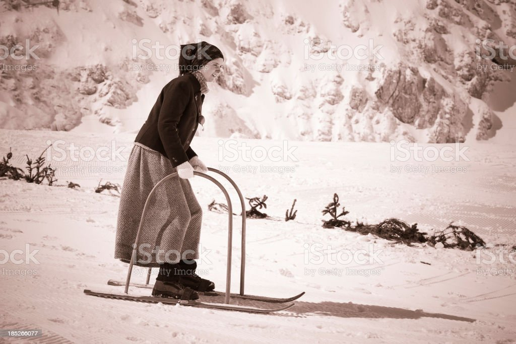 \'Side view of young female retro skier, ski equipment from 1950\'s,...