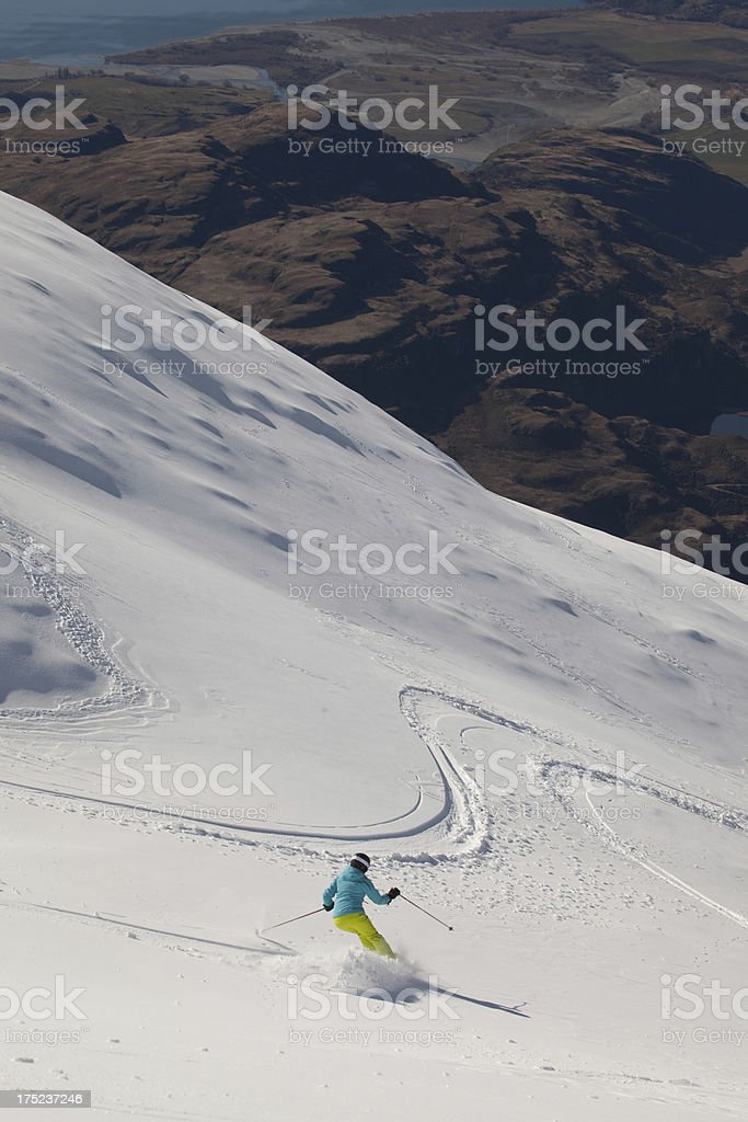 young women skiing powder snow, New Zealand royalty-free stock photo
