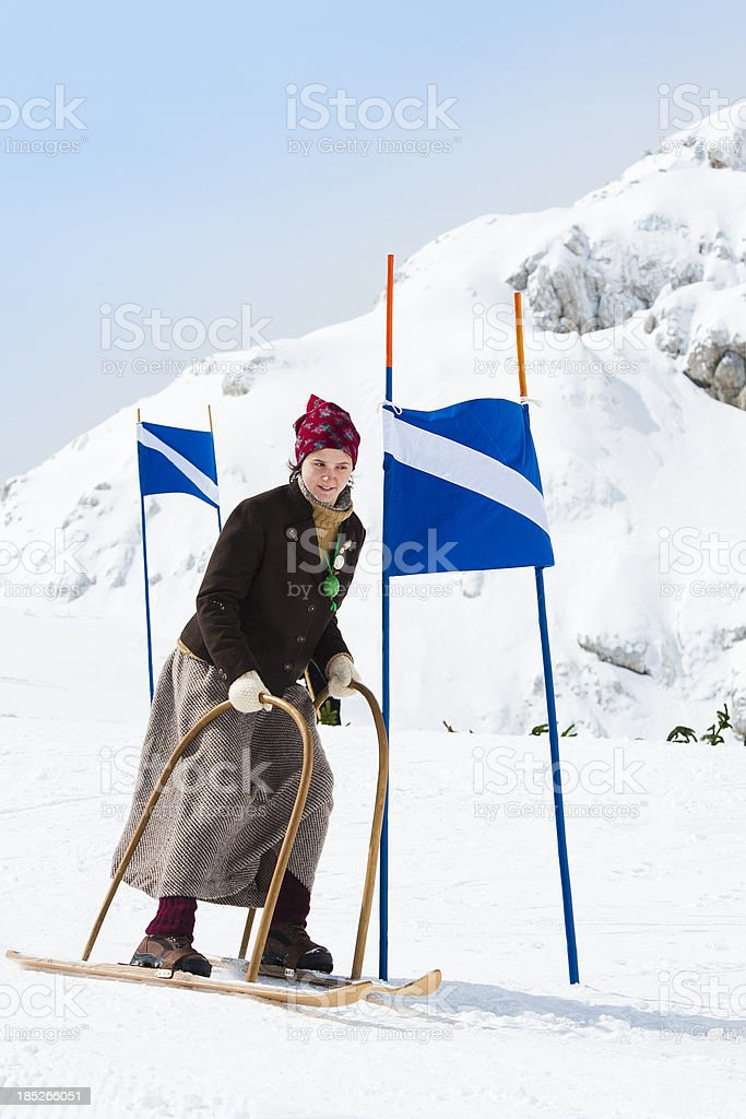 Young women skiing using retro ski equipment royalty-free stock photo