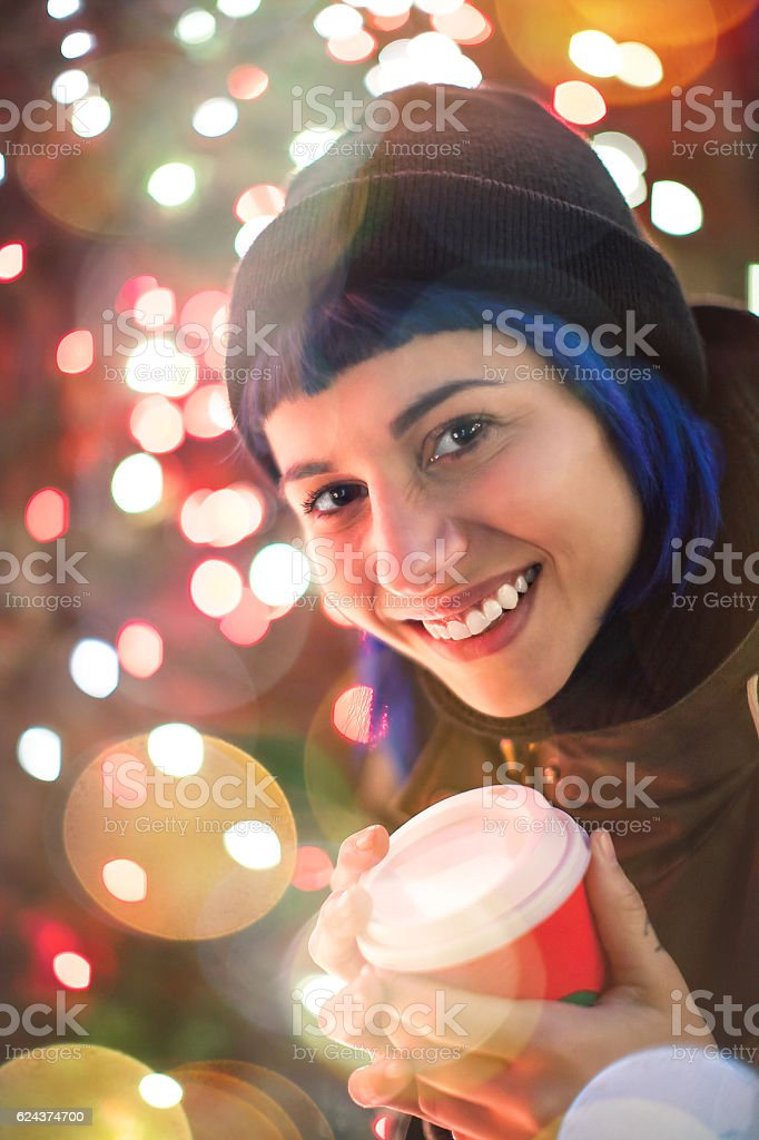 Young women smiling outdoor at Christmas stock photo