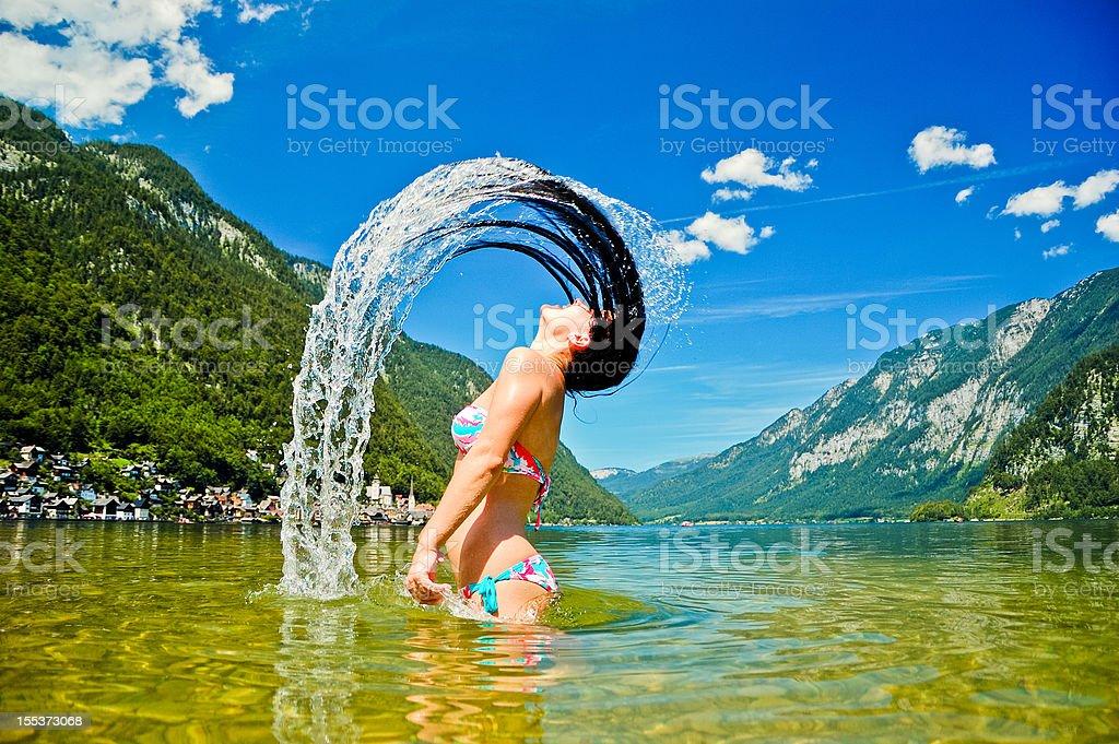 Young women splashing in the lake royalty-free stock photo