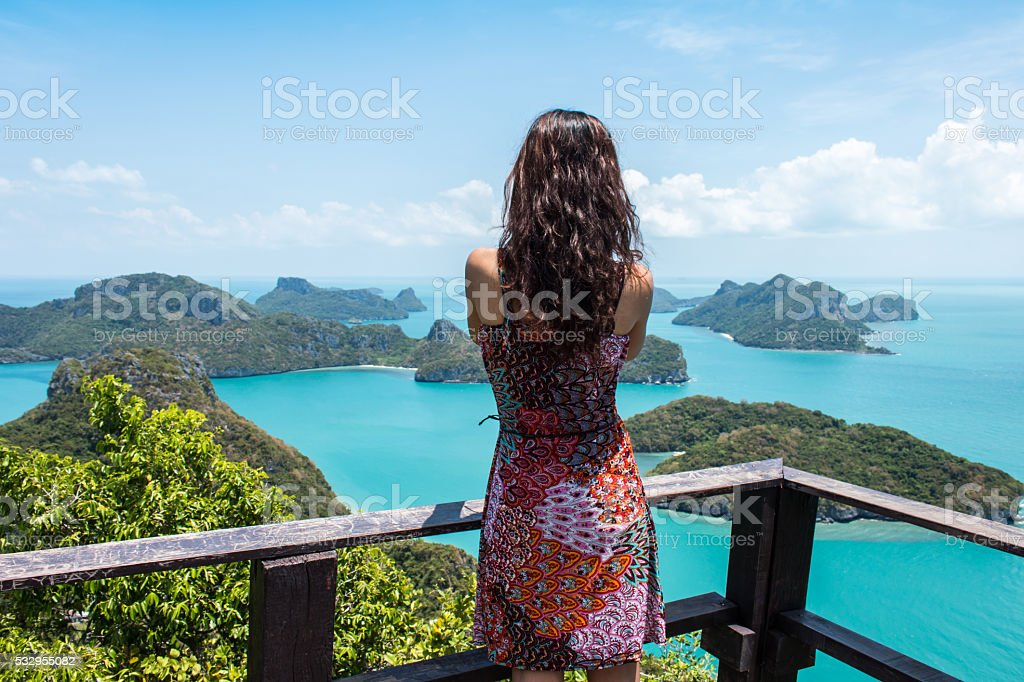 Young women standing at pake  mountain Angthong Islands stock photo