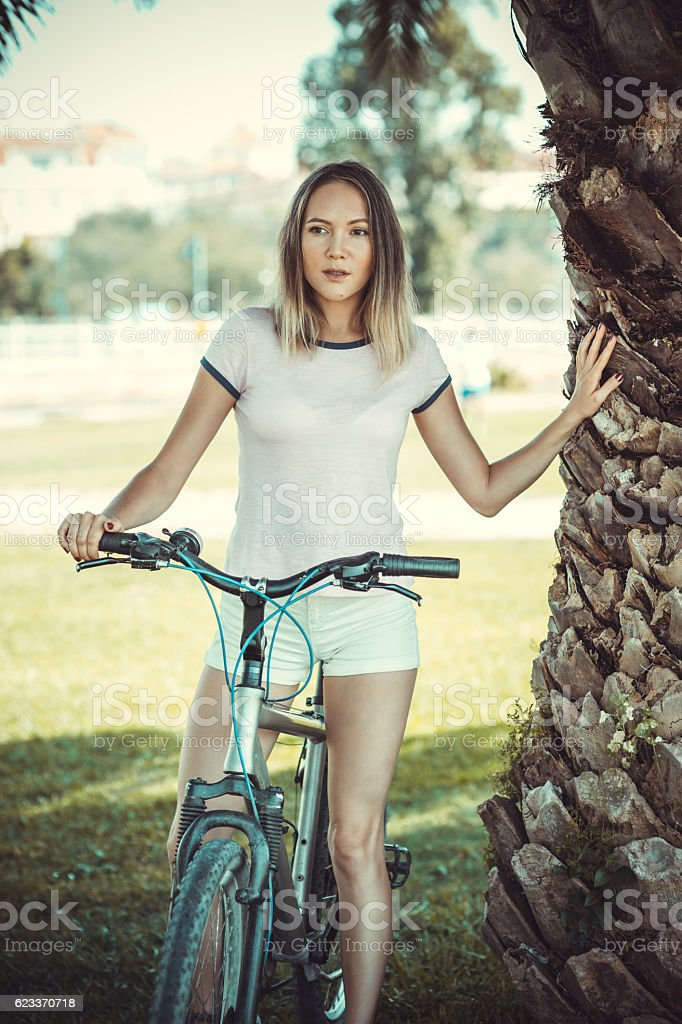 Young Women stay with rented bicycles stock photo