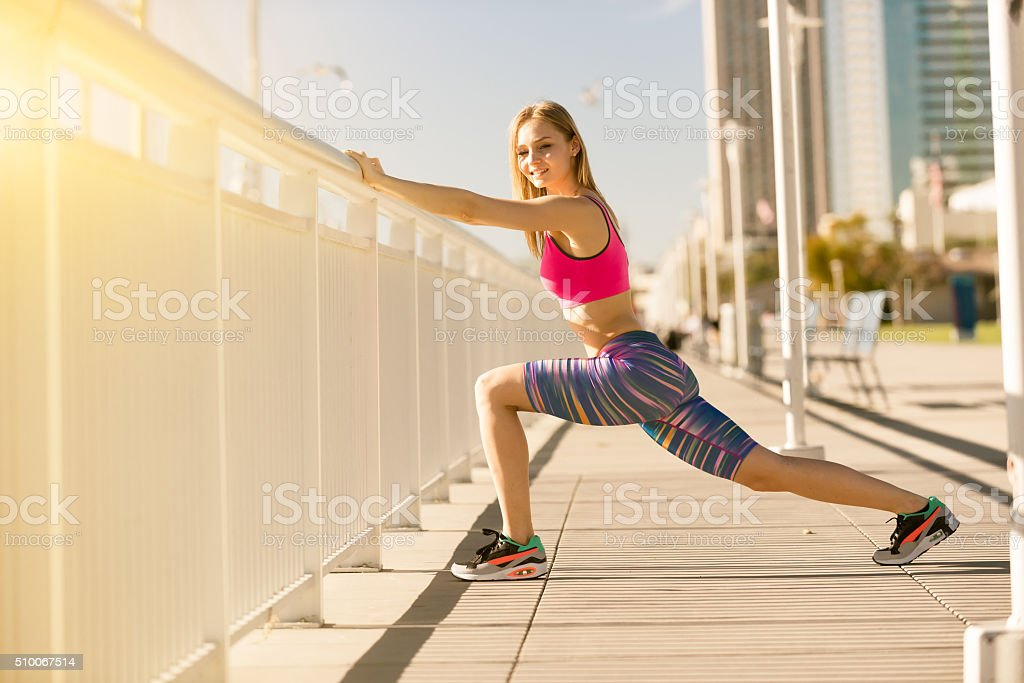 Young Women Stretching On The San Diego Waterfront stock photo