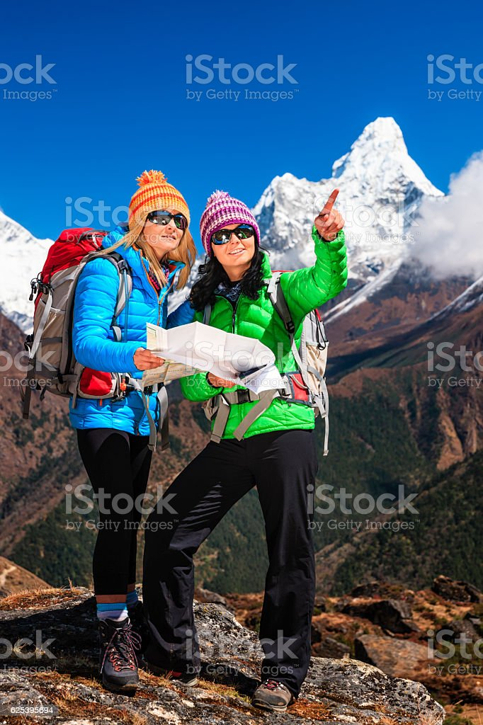 Young women studying map in Himalayas, Mount Everest National Park stock photo