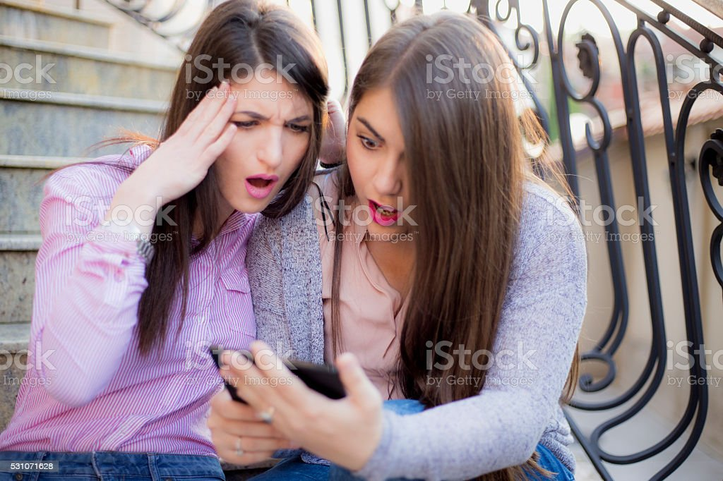 Young Women Surprised by Text Message stock photo