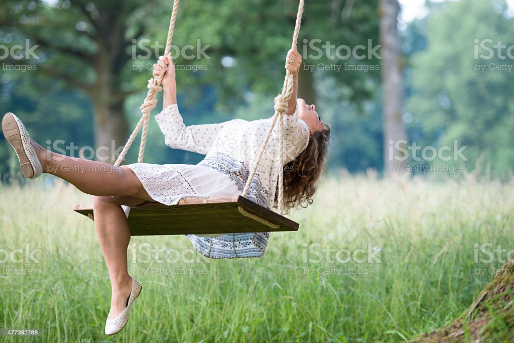 Young Women Swinging stock photo