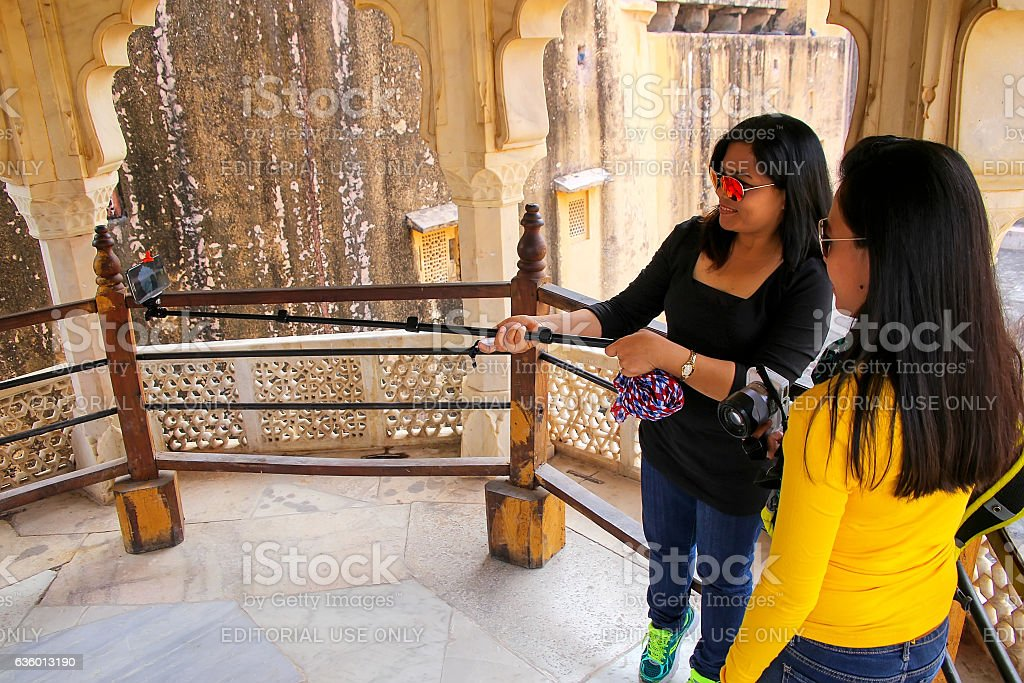 Young women taking selfie in Amber Fort, Rajasthan, India stock photo