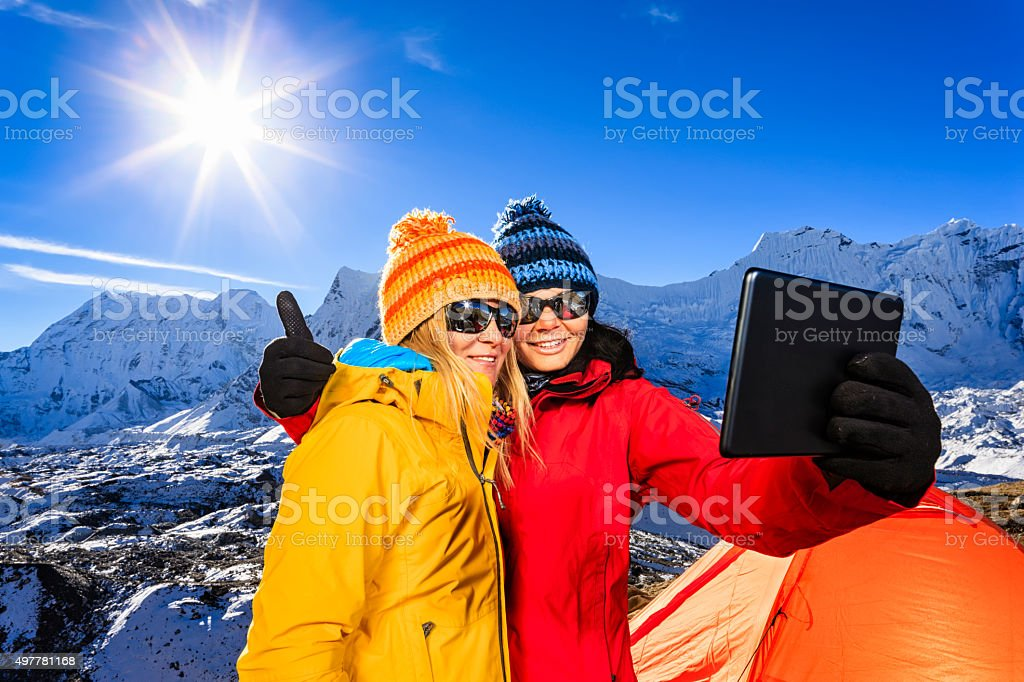 Young women taking selfie in Himalayas, Mount Everest National Park stock photo