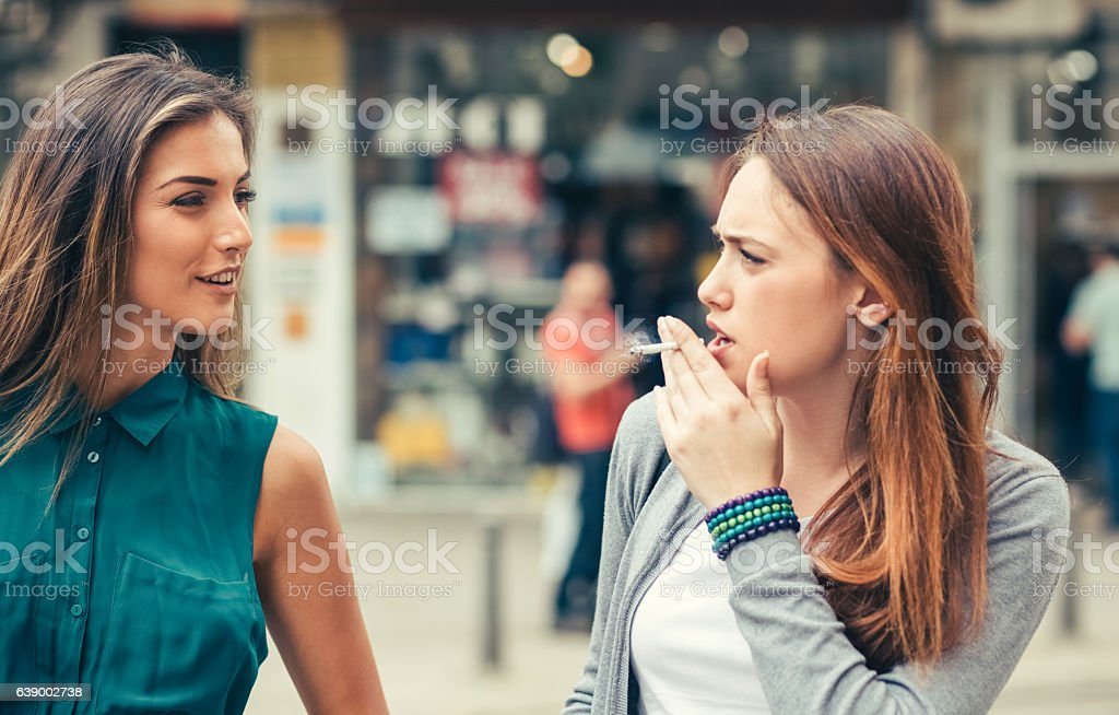 Young women talking outside stock photo