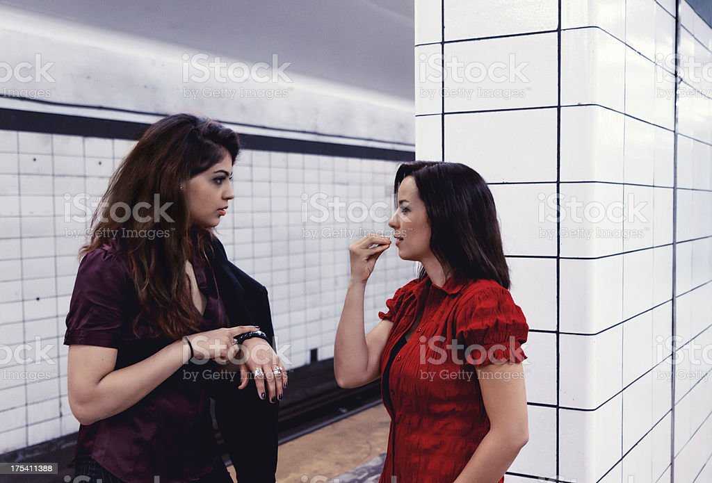 Young Women Talking Sign language Waiting For A Train stock photo