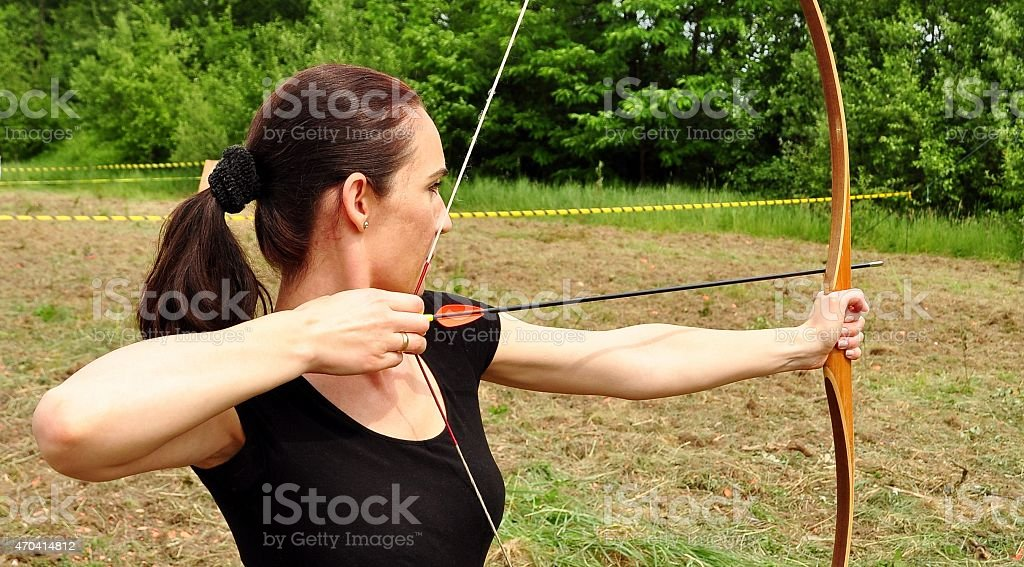 Young women training with the bow stock photo