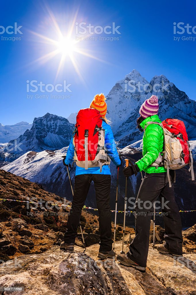 Young women trekking in Himalayas, Mount Everest National Park stock photo