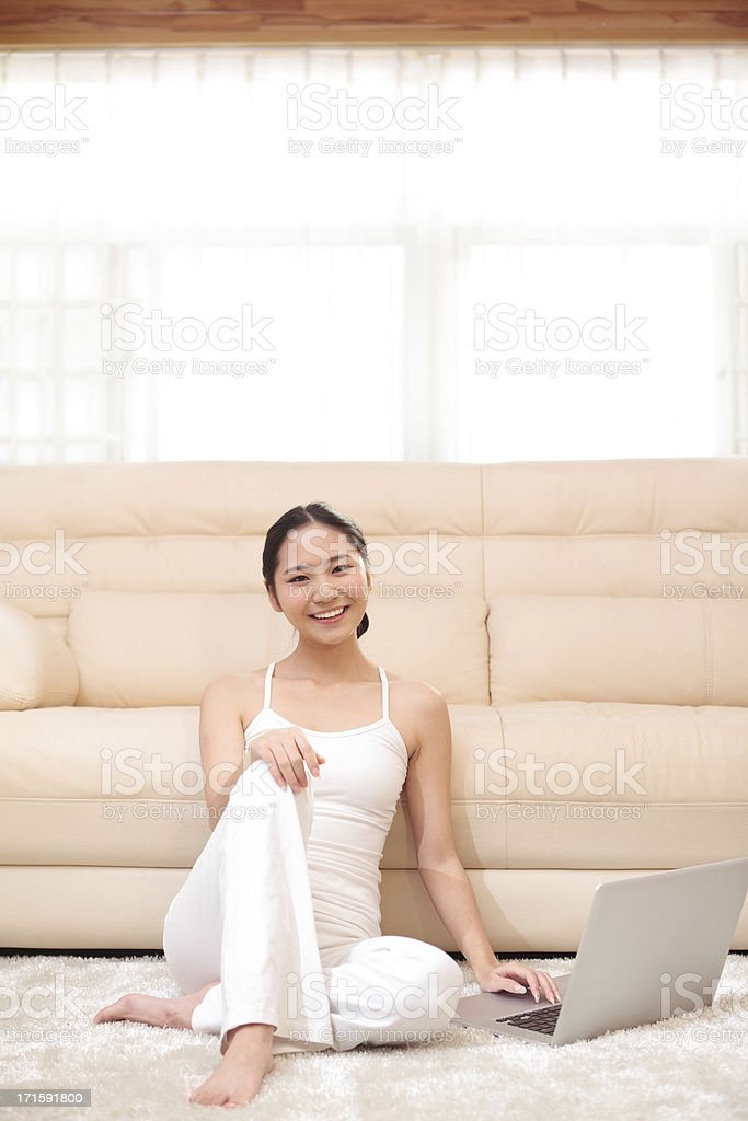 young women use laptop in home royalty-free stock photo