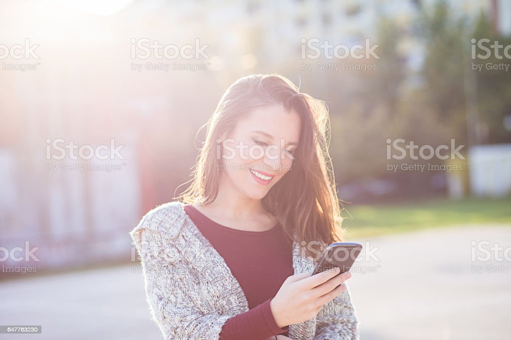 Young women using smart phone stock photo