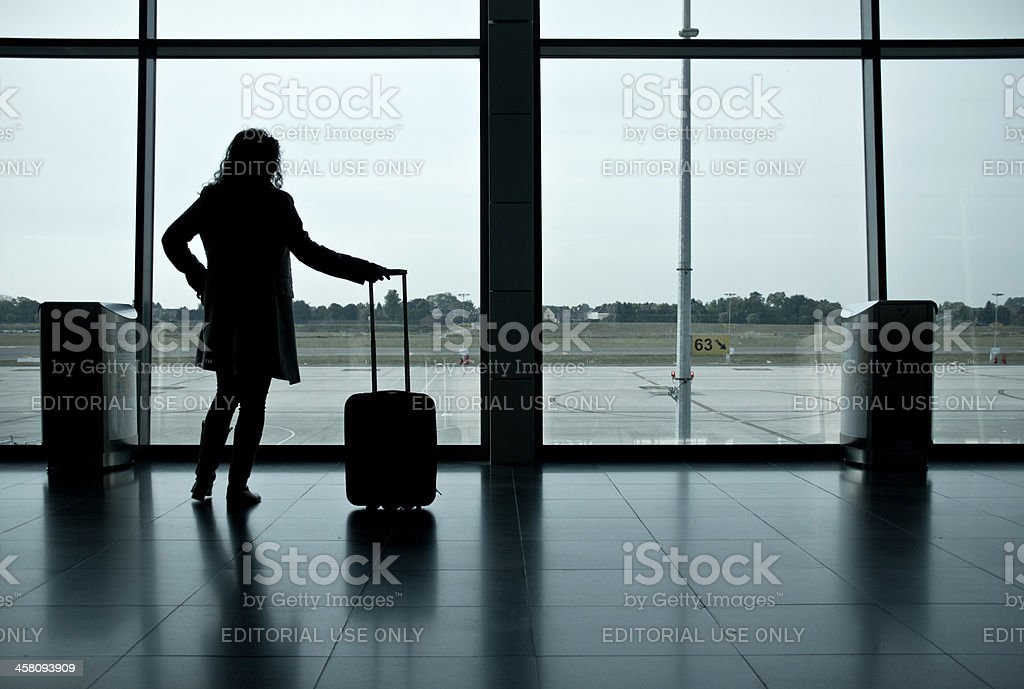 Young women waiting at the airport for airplane royalty-free stock photo