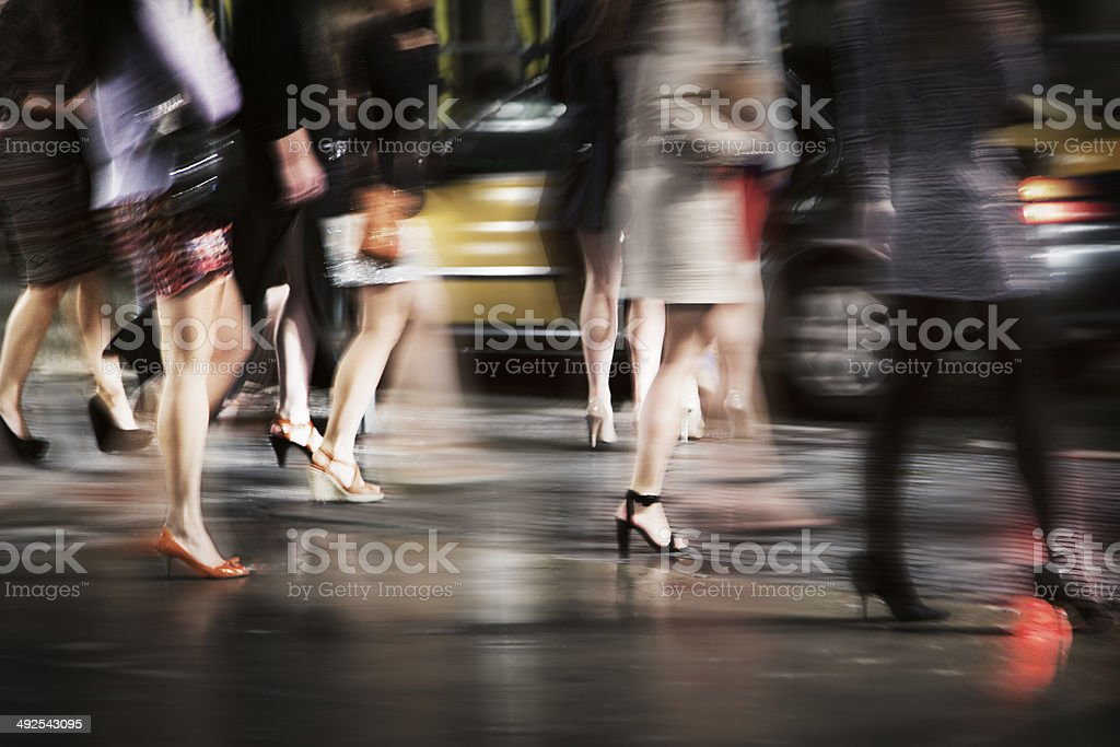 Young Women walk on the street at night stock photo