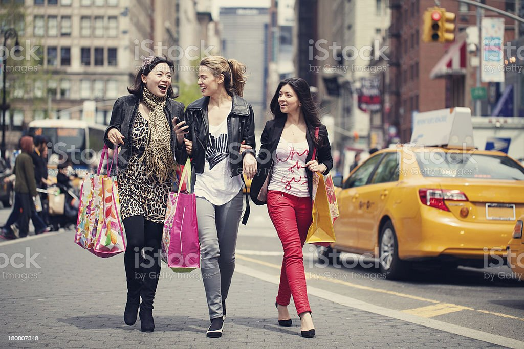 Young women walking and shopping in New York City royalty-free stock photo