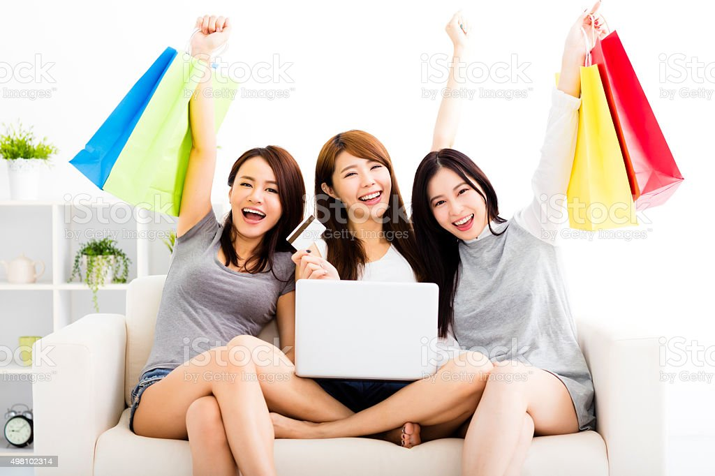 young women watching laptop with on line shopping concept stock photo