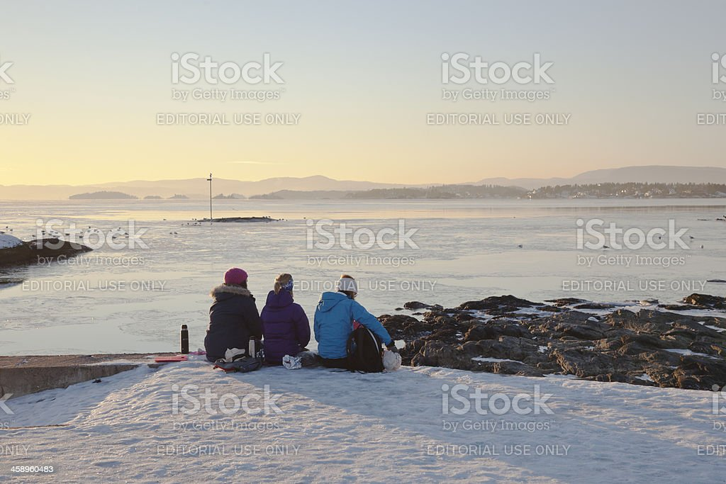 Young women  watching the  sunset. stock photo
