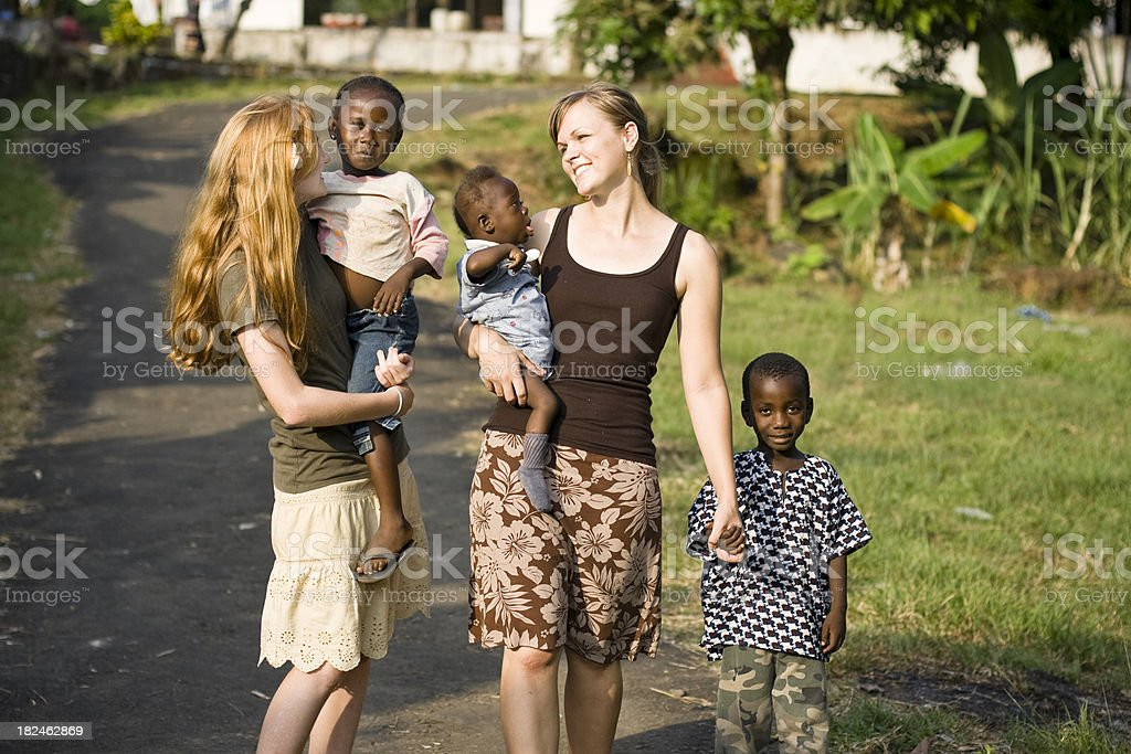 Young Women With African Children stock photo