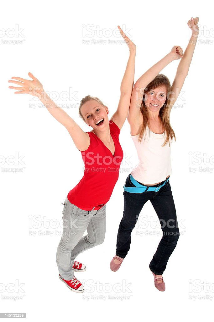 Young women with arms raised royalty-free stock photo