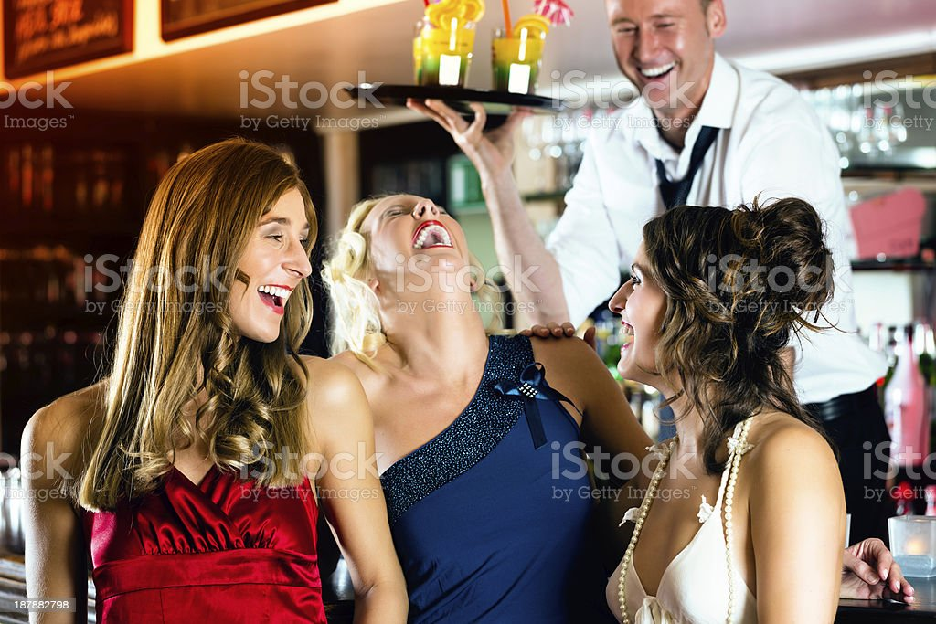 Young women with cocktails in club or Bar royalty-free stock photo