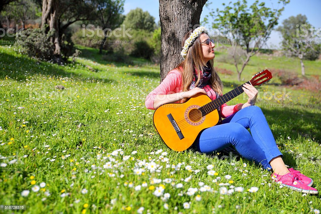 Young women with guitar in outdoor stock photo