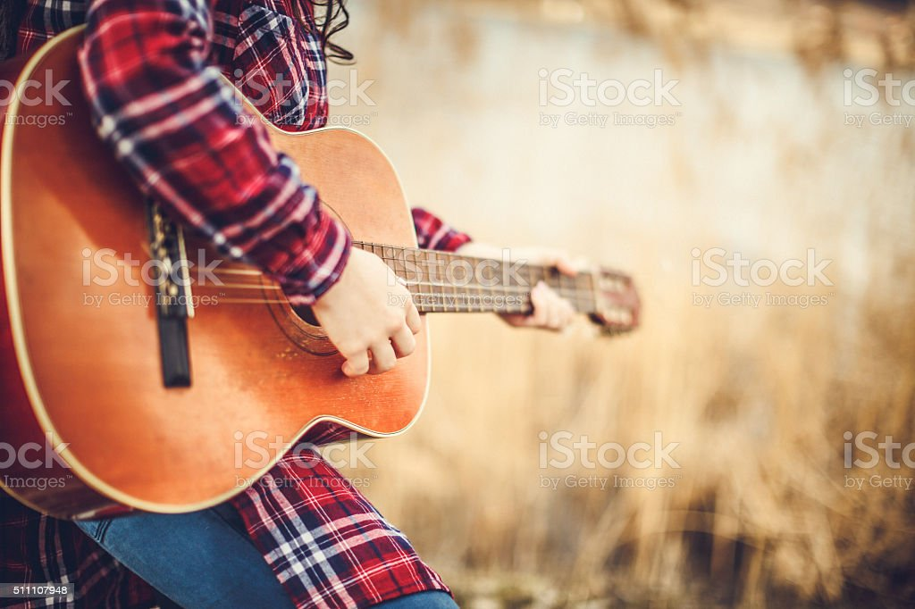 young women with guitar stock photo