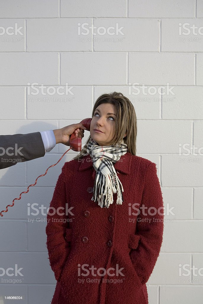 Young Women With Phone To Her Ear royalty-free stock photo