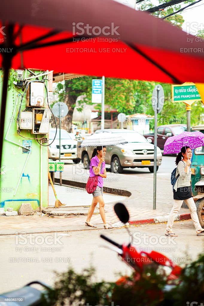 Young women with umbrellas in Vientiane stock photo