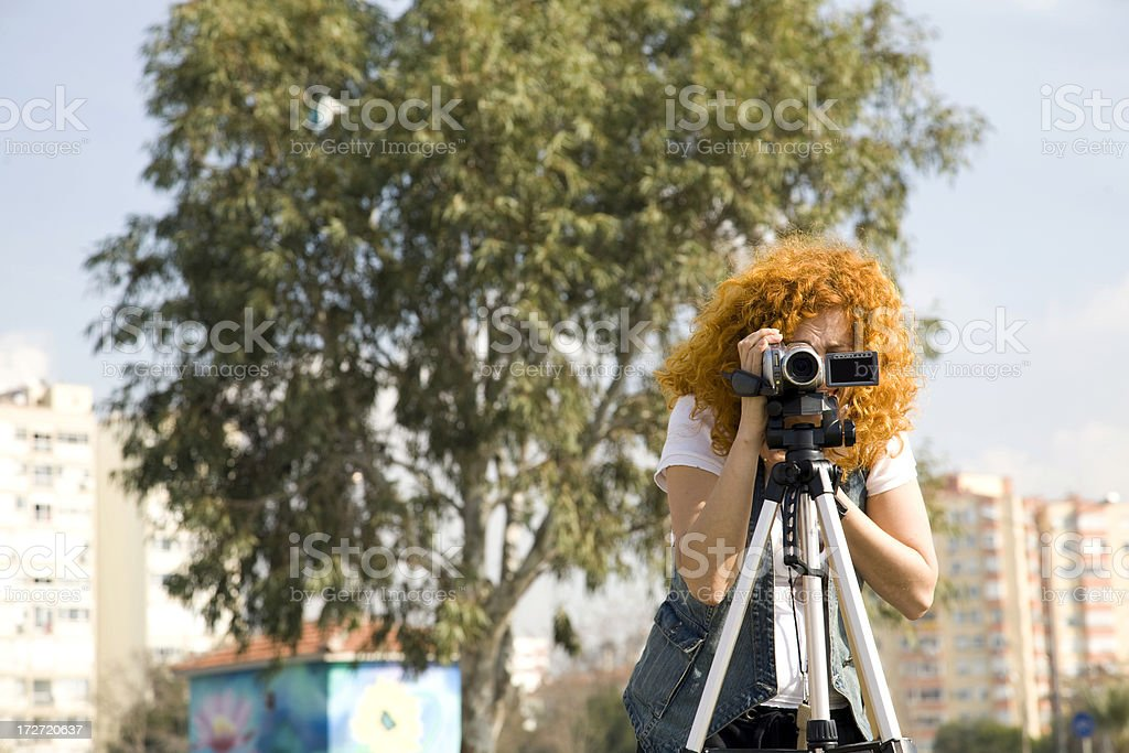 Young women with video camera royalty-free stock photo