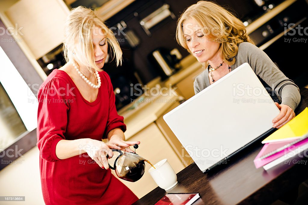 Young Women working and drinking coffee royalty-free stock photo