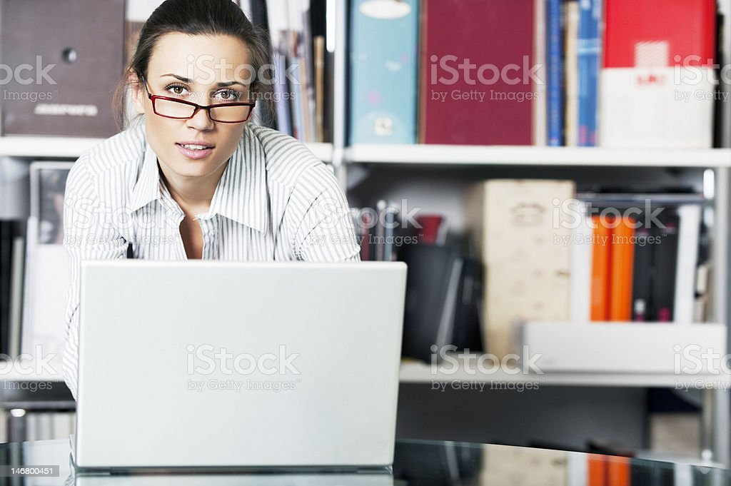 Young women works in the office with glasses royalty-free stock photo