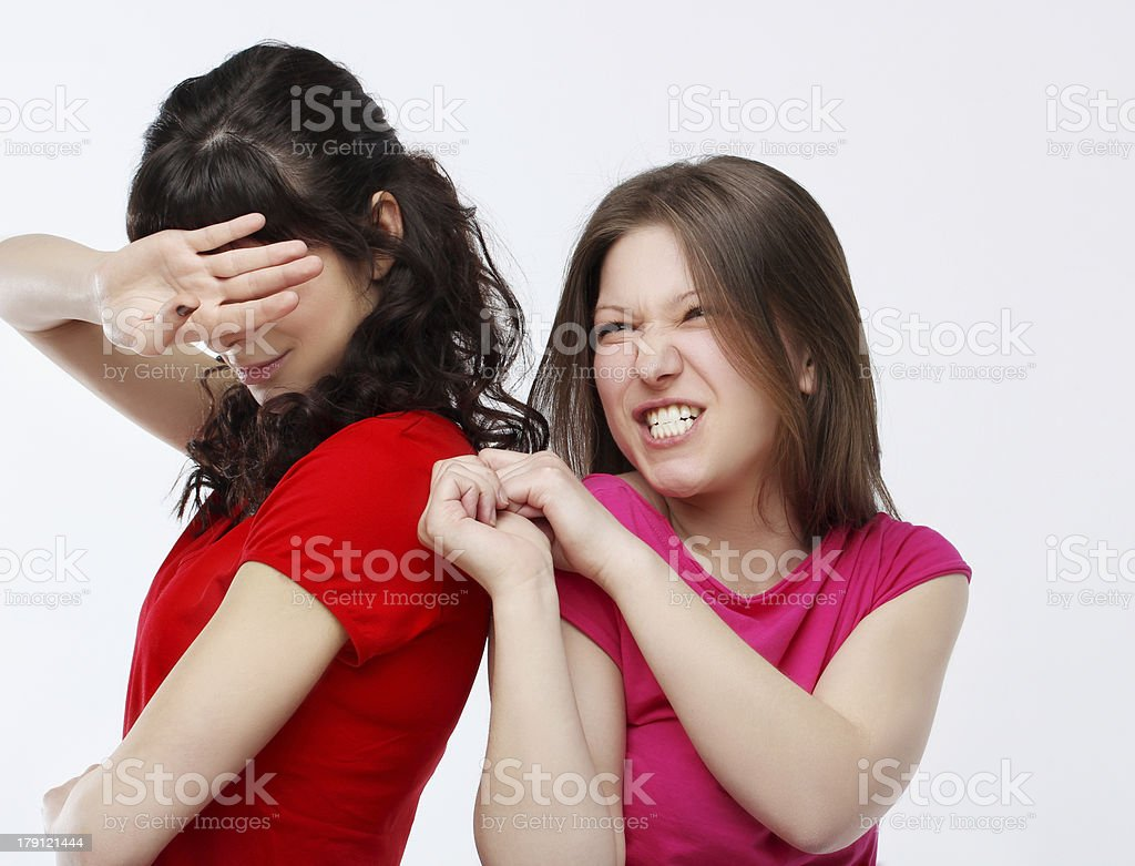 Young women yelling at friend royalty-free stock photo