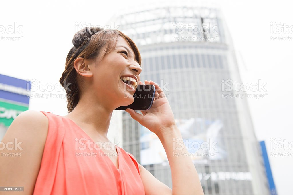 young womon calling by smartphone at Shibuya crossing stock photo