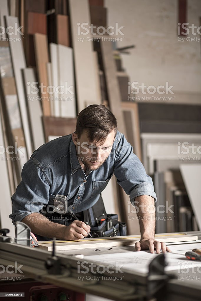 Young woodworker working in carpentry stock photo
