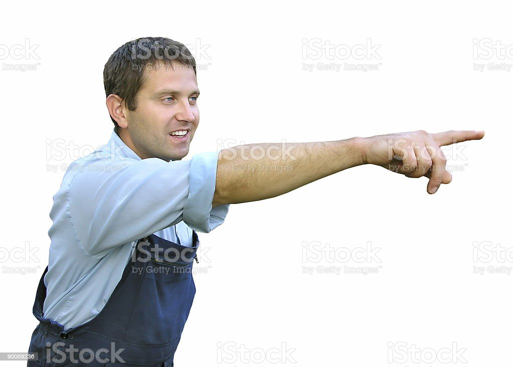 Young worker in working clothes, pointing with finger royalty-free stock photo