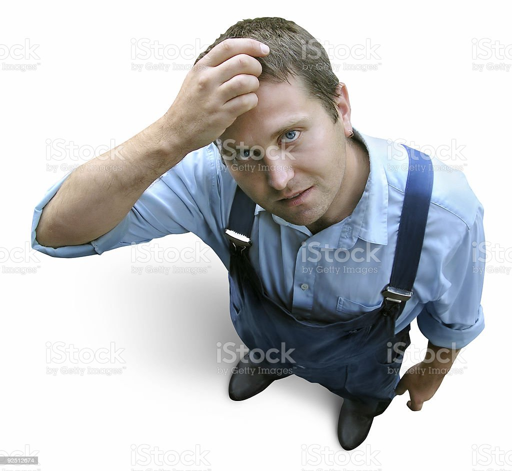 Young worker in working clothes, wondering and hesitating. Looke royalty-free stock photo