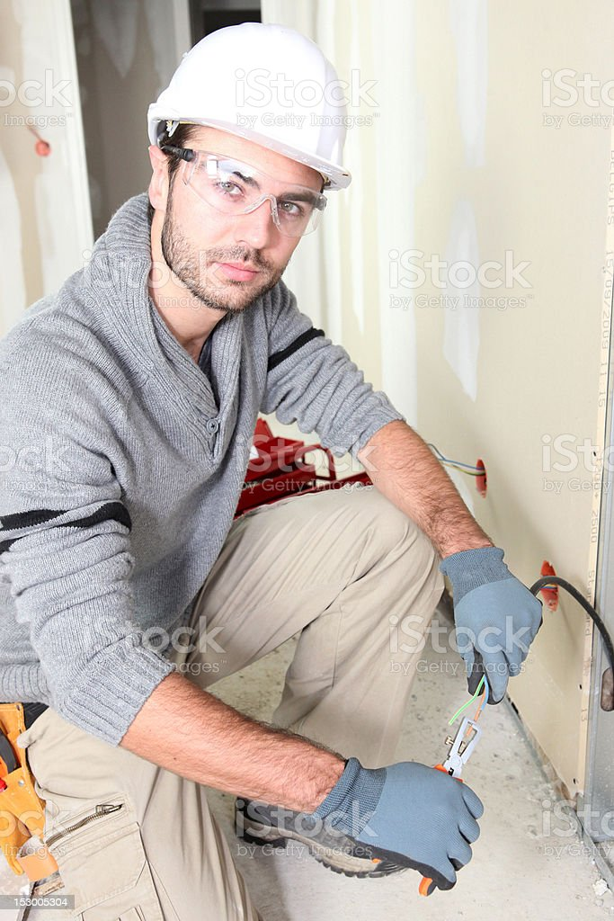 Young worker on a construction site royalty-free stock photo