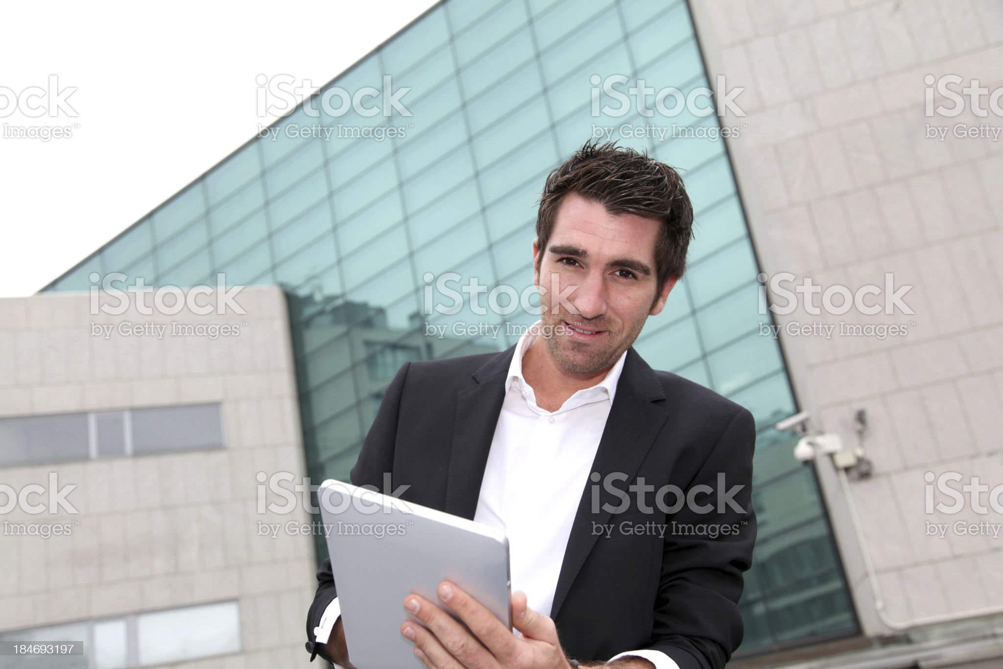 Young worker websurfing with tablet outdoor royalty-free stock photo