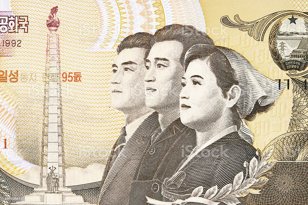 Young Workers and Juche Tower on Banknote royalty-free stock photo